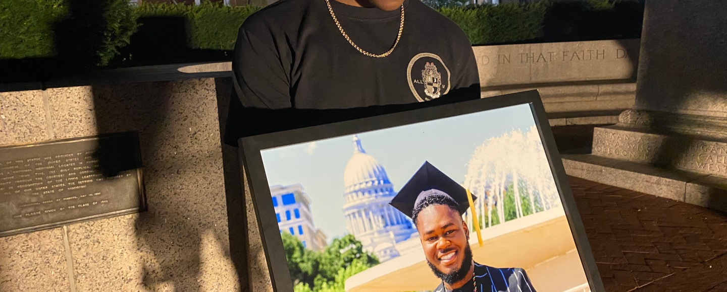 Anthony Pittman holds a photo of Darrell Foster.