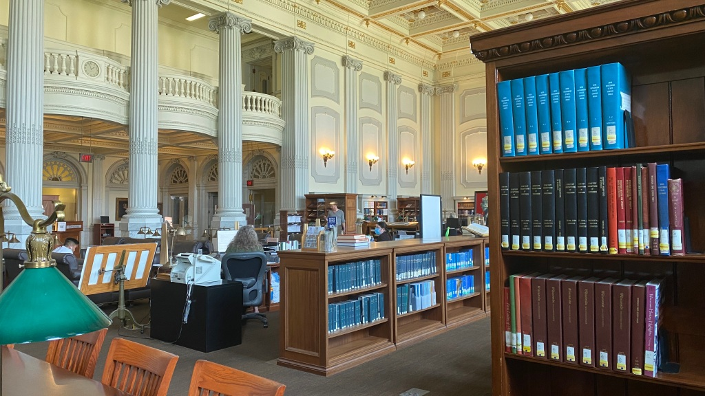 A bookshelf and table at the Wisconsin State Historical Society library.
