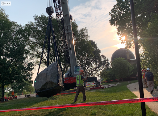 A construction worker removes Chamberlain Rock on the morning of Friday, Aug. 6, 2021.